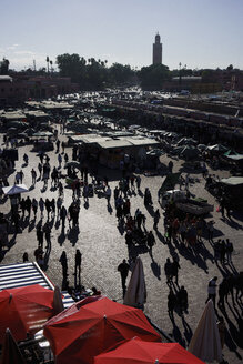 View of bustling souk market in Djemaa El Fna Square, Marrakesh, Morocco - FSIF03709
