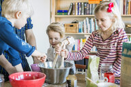 Children mixing batter at home - ASTF02170