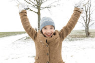 Portrait of happy boy in winter landscape - KMKF00704