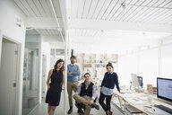 Portrait confident architects in open plan office - HEROF05855