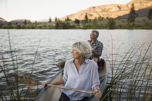 Retired couple canoeing on lake - HEROF05947