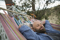Serene man relaxing in hammock - HEROF06028