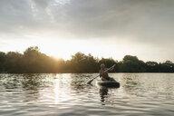 Senior man on SUP board at sunset - GUSF01814