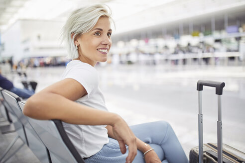 Young woman waiting at the airport - PNEF01141