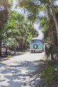 Mexico, Yucatan, Quintana Roo, Tulum, camper van on the beach with palm trees - MMAF00777