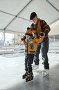 Serbia, Novi Sad, Ice skating, Grandfather and grandson, Help - ZEDF01809