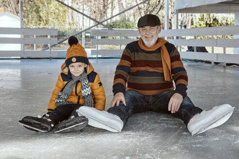 Serbia, Novi Sad, Ice skating, Grandfather and grandson, On the ground - ZEDF01812