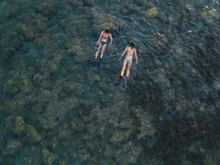 Women snorkeling in ocean, Amed beach, Bali, Indonesia - KNTF02605