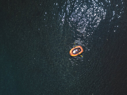 Asian man in rubber boat - KNT02611
