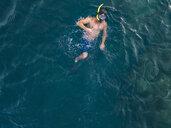 man snorkeling in ocean, Amed beach, Bali, Indonesia - KNTF02620