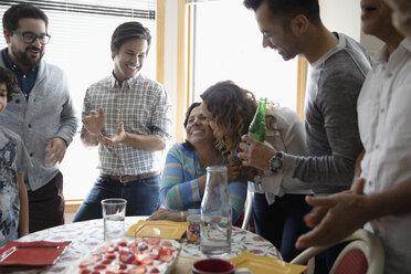 Affectionate Latinx family celebrating grandmothers birthday - HEROF06330