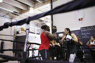 Boxers training in boxing ring in gym - HEROF06339