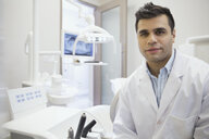 Portrait of confident dentist in office - HEROF06348