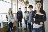 Portrait of high school students in corridor - HEROF06453