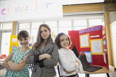 Portrait of confident school girls at science fair - HEROF06522
