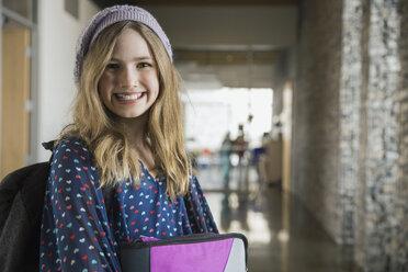 Portrait of confident school girl in corridor - HEROF06528