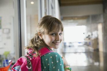 Portrait of confident school girl in corridor - HEROF06534