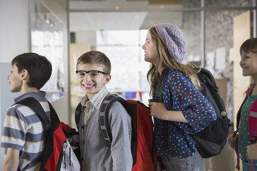 Portrait of confident school boy in corridor - HEROF06540