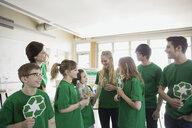Mentors and students with recycle symbols in classroom - HEROF06555