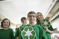 Mentors and students with recycle symbols in classroom - HEROF06558