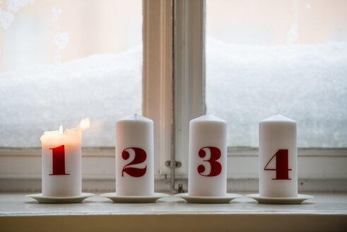 Numbered candles, one burning - ASTF02494