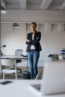 Portrait of confident businesswoman standing in office - JOSF03010