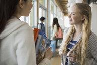 High school students talking in corridor - HEROF06585