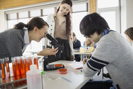 High school students using microscope in science class - HEROF06591