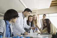 High school students and teacher conducting scientific experiment - HEROF06606