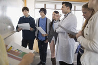 High school students and teacher at whiteboard - HEROF06618