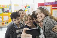 Elementary students and teacher taking selfie - HEROF06768