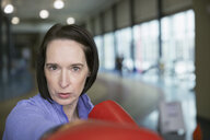 Close up portrait of serious woman boxing - HEROF06963
