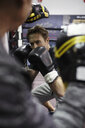 Focused male boxer training in gym - HEROF07380