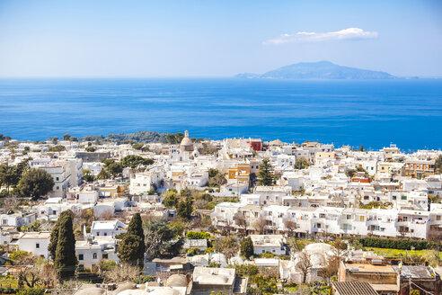 Italy, Campania, Gulf of Naples, Capri Island, aerial view of its buildings against Thyrrenian Sea - FLMF00097