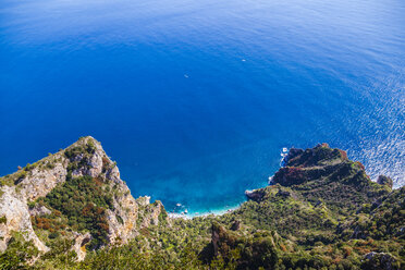 Italy, Campania, Gulf of Naples, Capri Island, Anacapri, aerial view from Monte Solaro over paradisiacal cliffs and beaches on Thyrrenian Sea - FLMF00100