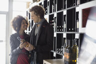 Couple shopping in wine store - HEROF07502
