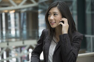 Businesswoman talking on cell phone - HEROF07586