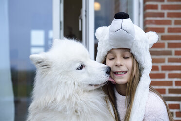 Portrait of girl on terrace with her white dog - ECPF00284