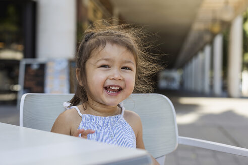 Portrait of happy little girl outdoors - MAUF02398