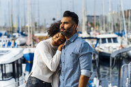 Spain, Barcelona, affectionate couple at the marina - BOYF01294