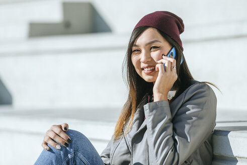 Portrait of smiling young woman on  the phone - KIJF02213