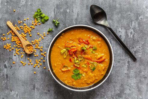 Soup bowl of garnished red lentil soup and ingredients - SARF04064