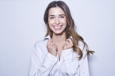 Portrait of laughing young woman wearing white blouse - PNEF01170
