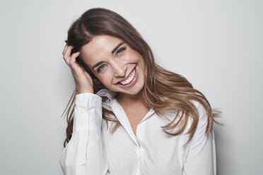 Portrait of laughing young woman wearing white blouse - PNEF01173