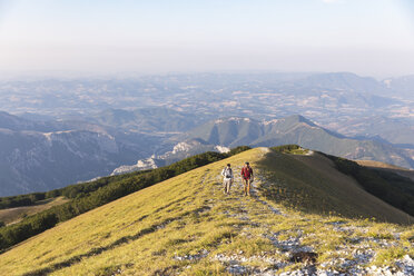 Italy, Monte Nerone, two men hiking on top of a mountain in summer - WPEF01303