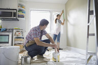 Couple starting painting project in living room - HEROF07864