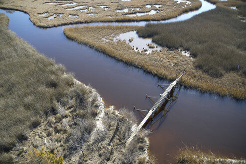 Marsh on the Eastern Shore of Maryland with a walking path and pedestrian bridge.  This area is experiencing sea level rise due to global warming. - BCDF00378