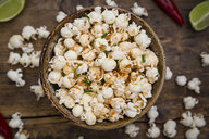 Bowl of popcorn flavoured with chili and lime - LVF07695