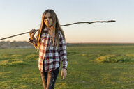 Portrait of girl playing with stick in nature - ERRF00680