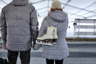 Couple standing at the ice rink - ZEDF01825